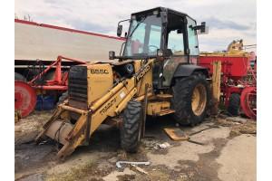 Dezmembrez pt piese buldoexcavator Ford-New Holland 655C