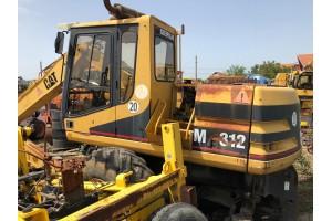 Excavator pe pneuri Caterpillar M312